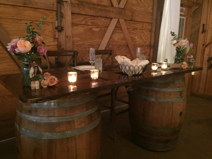 [Image: Rustic bride and groom table complete with china and fluted champagne glasses! ]